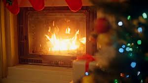 background with decorated christmas tree and burning fireplace at