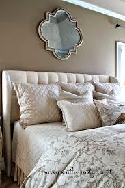 neutral bedroom upholstered headboard tufted restoration
