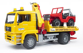 amazon com bruder man tga tow truck with cross country vehicle