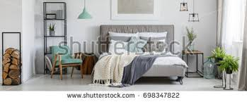 silver painting above kingsize bed knit stock photo 727399630
