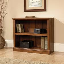 Cherry Bookcase With Glass Doors by Bookcase Aubrie Cherry Bookcase With Wooden Panel Doors Y332