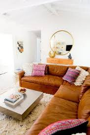 Cognac Leather Sofa by Big Old Scuffed Soft Leather Couches With A Glass Of Wine And