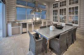 covered patio with outdoor kitchen and zinc outdoor dining table