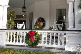 christmas porch decorations create a festive christmas porch with wreaths hanging along railings and down the staircase