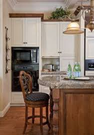 white kitchen cabinets with wood crown molding crown molding with light cabinets kitchen