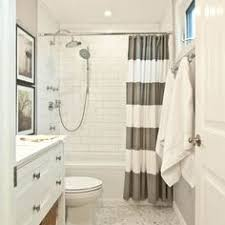 Black And White Vertical Striped Shower Curtain I Love The Height Of The Shower Curtains And How They Used Two