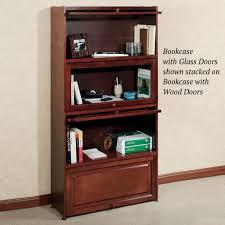 aubrie cherry bookcase with wooden panel doors