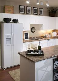 should i decorate on top of my kitchen cabinets decorating above kitchen cabinets 10 ways small