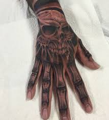 skull hand tattoos designs ideas and meaning tattoos for you