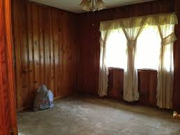 stained wood panels how to decorate around dark wood paneling