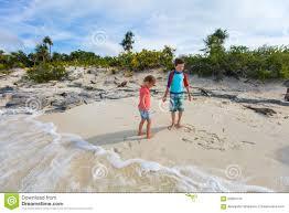 iguana island two kids at beach of iguana island stock image image 62984133