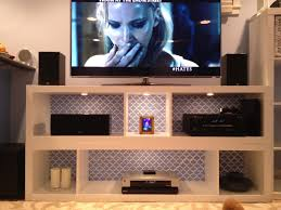 modern tv stand in white with mount and shelves from ikea