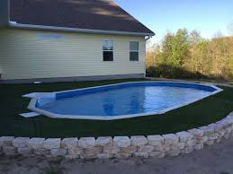 Backyard Above Ground Pools by Done Artificial Turf Surrounding A Sunken Above Ground Pool