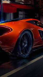mclaren hypercar orange mclaren p1 hypercar in the city wallpaper download 1080x1920