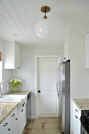 the best white paint to use on kitchen cabinets choosing the best white paint color for your kitchen cabinets