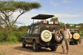 safari land cruiser on safari in tanzania