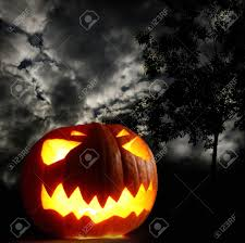 halloween pumpkins background angry halloween pumpkin on thunder sky background stock photo