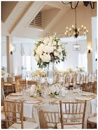 gold ivory and wedding reception decor with florals