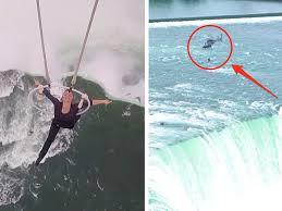 nissan canada niagara falls woman uses her teeth to hang from a above niagara falls