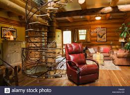 Red Leather Chair Spiral Shaped Wood And Wrought Iron Staircase And Red Leather