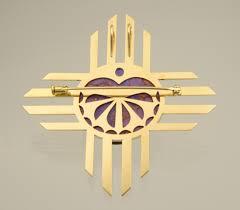 metalwork from studio 7 zia sun symbol pin