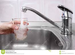kitchen drinking water faucet hand with glass of water poured from kitchen faucet stock image