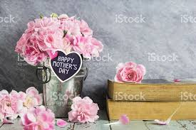 happy mothers day letter on wood heart and pink carnation stock