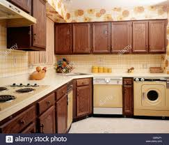 yellow kitchen wood cabinets 1970s kitchen interior with yellow appliances wood cabinets