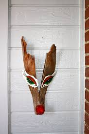 such a cute reindeer made out of palm tree bark home for the