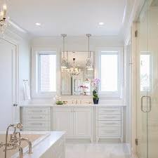 white master bathroom ideas all white master bathroom with chandelier tub transitional