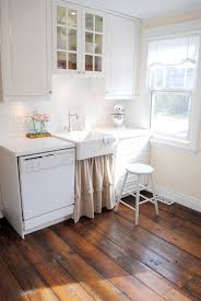 canadian kitchen cabinets canadian cottage u0027s diy barnboard floors the inspired room