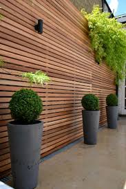 outdoor wood plank privacy screen and fences adorning privacy
