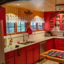 blue kitchen cabinets in cabin cabinetry kitchens and baths timber country cabinetry