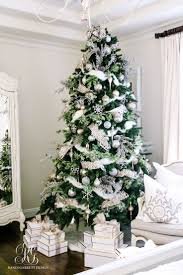 astonishing tree with white ornaments