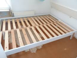 a pull out single to double bed made from a hacked ikea bed could
