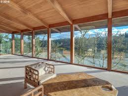 own a dreamy 1965 lake house with spectacular views curbed