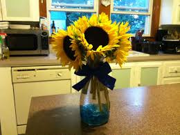 table centerpieces with sunflowers sunflowers in a carafe as centerpieces wedding pinterest