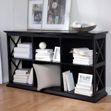 interior immaculate black painted low bookcase with portray
