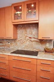 Kitchen Depot New Orleans by Granite Countertop Zebra Wood Cabinets Kitchen Orange Backsplash