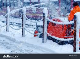 cleaning snow machine snow thrower machine stock photo 517819510