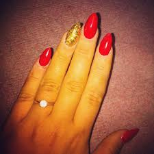 red and gold glitter acrylic stiletto nails rock n roll nails