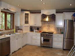 having white finish varnished wooden kitchen cabinet glass top