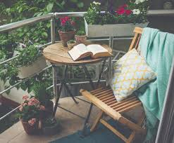 beautiful terrace or balcony with small table chair and flowers