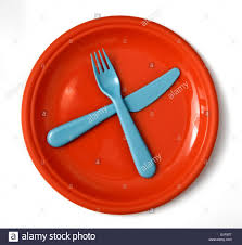 children u0027s plastic plate with blue knife and fork stock photo