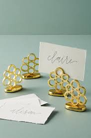 brass table number holders a place at the table festive place card holders the inspired room