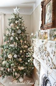 white and chagne colored ornaments for tree