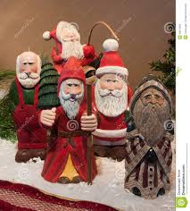 carved santa claus figures stock images image 30673934