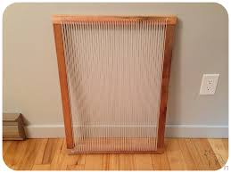 after testing out my weaving skills on a simple frame lap loom