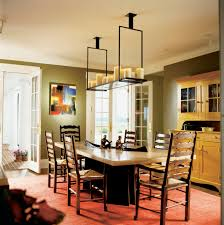 dining room chandeliers with french door and red carpet with