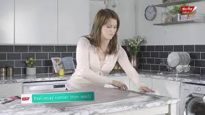 white gloss kitchen cupboard wrap applying vinyl to kitchen cupboards